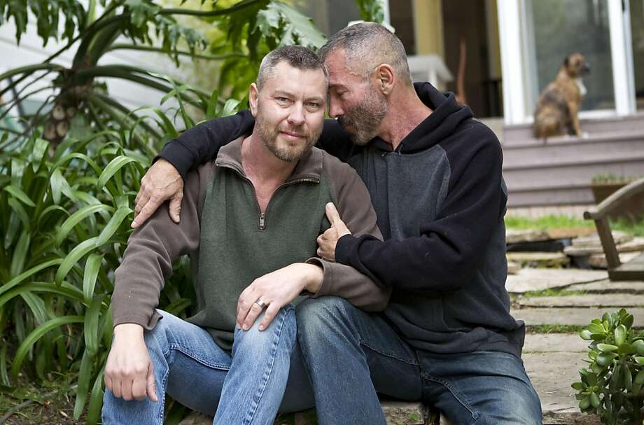 Anthony Makk (left) sits with Bradford Wells, his husband of seven years, at their home in San Francisco, Calif., on Friday, June 3, 2011.  Makk is an Australian citizen and must leave the country when his visa expires later this month leaving Wells, who has severe health complications from AIDS, without his husband and caregiver. The couple faces this problem because the 1996 Defense of Marriage Act denies all federal benefits, including spousal immigration benefits, to same-sex couples. Photo: Laura Morton, Special To The Chronicle