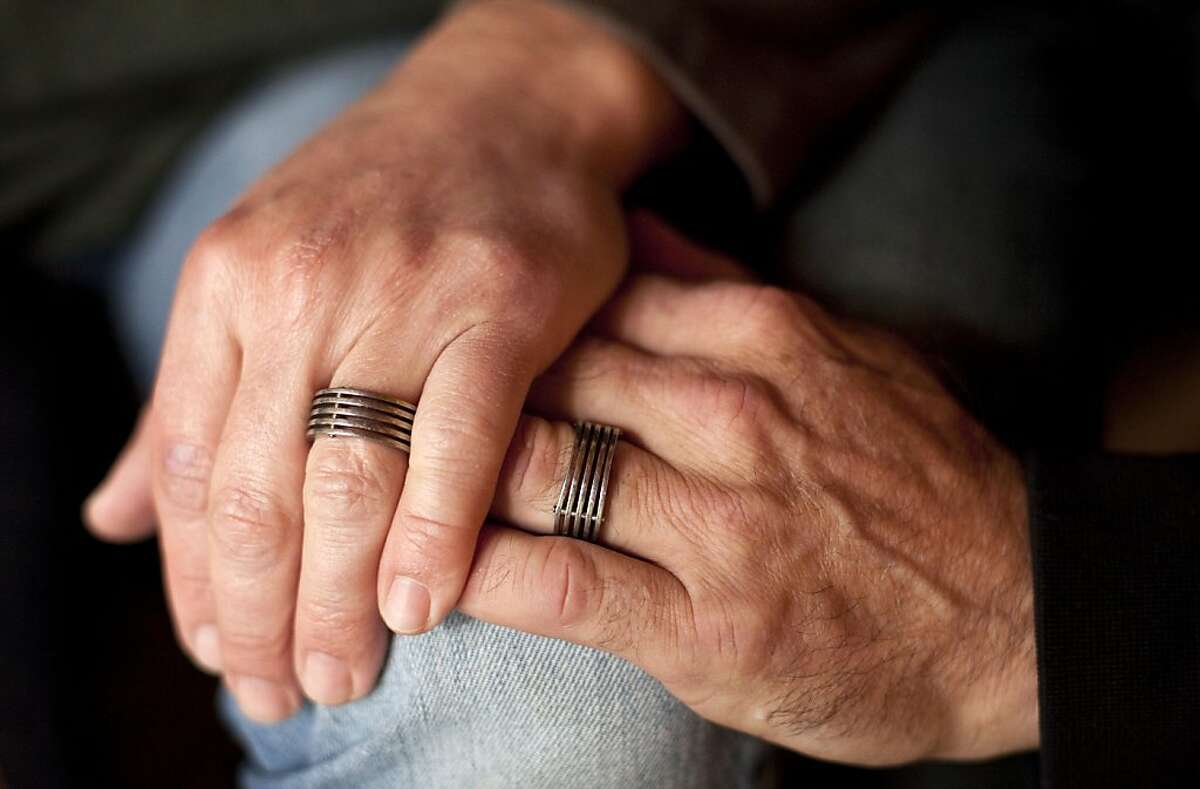 Anthony Makk and Bradford Wells hold hands and display their wedding rings at their home in San Francisco, Calif., on Friday, June 3, 2011. The couple, who married 7 years ago in Massachusetts, face separation because Makk is an Australian citizen and his visa expires later this month.