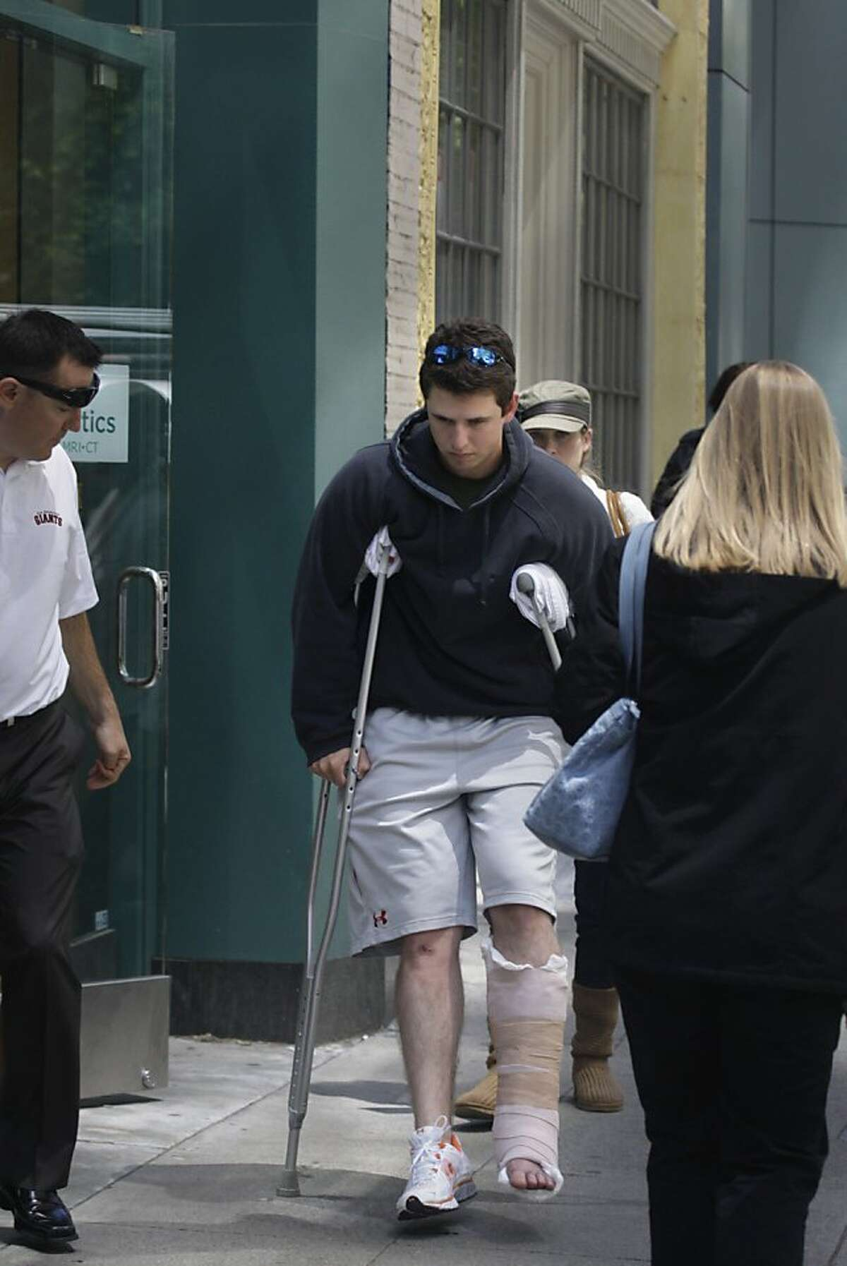 Giants catcher Buster Posey is seen leaving Health Diagnostics the day after breaking his leg in San Francisco, Calif., Thursday, May 26, 2011. Posey broke his leg on a play at home after colliding with Florida Marlins' Scott Cousins during the 12th inniGiants catcher Buster Posey is seen leaving Health Diagnostics the day after breaking his leg in San Francisco, Calif., Thursday, May 26, 2011. Posey broke his leg on a play at home after colliding with Florida Marlins' Scott Cousins during the 12th inning of a baseball game in San Francisco on Wednesday, May 25, 2011.