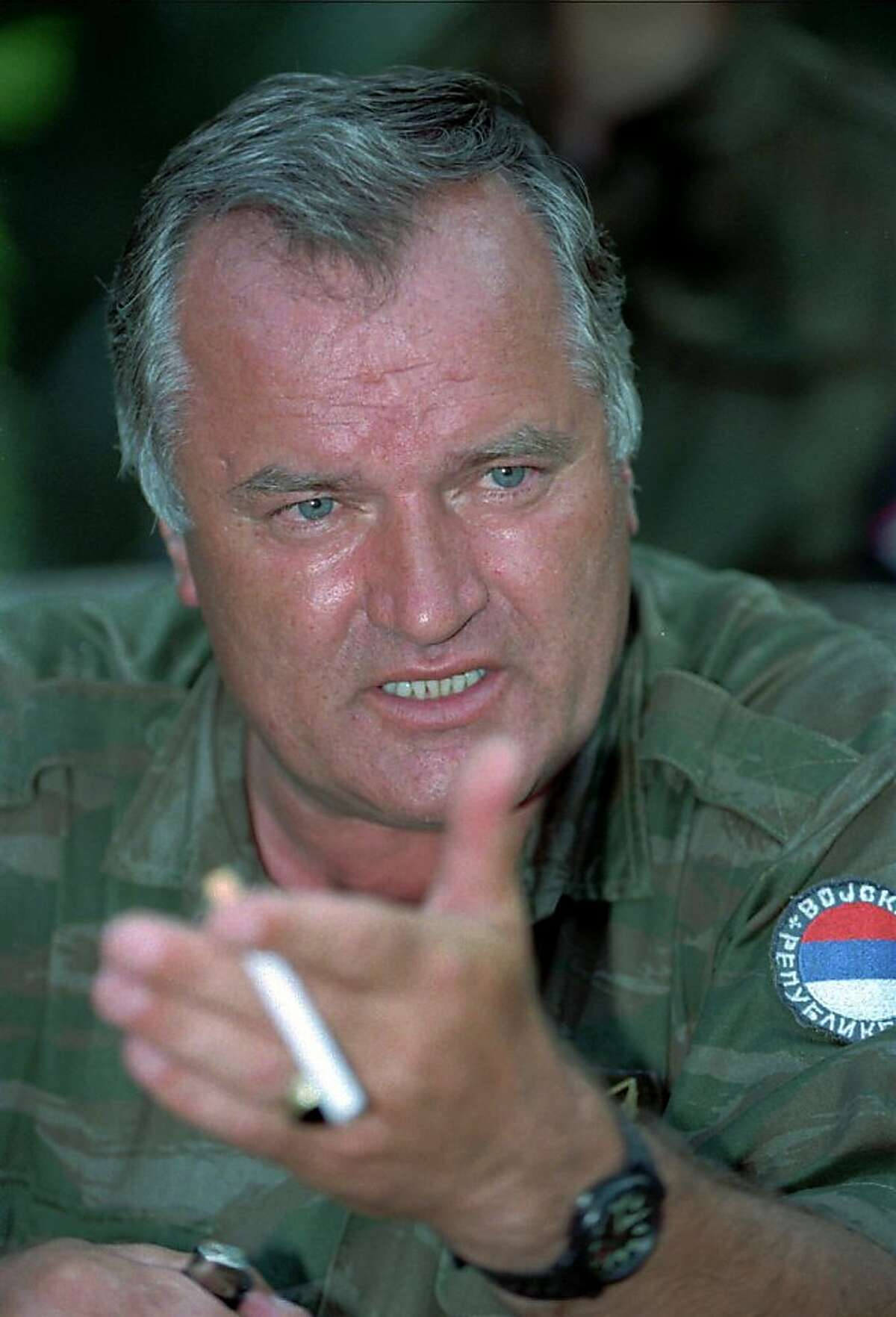 The Bosnian Serb army commander, General Ratko Mladic, gestures during talks with the media near the eastern Bosnian enclave of Zepa, some 50 miles (80 kilometers) east of Sarajevo, Wednesday July 26 1995.