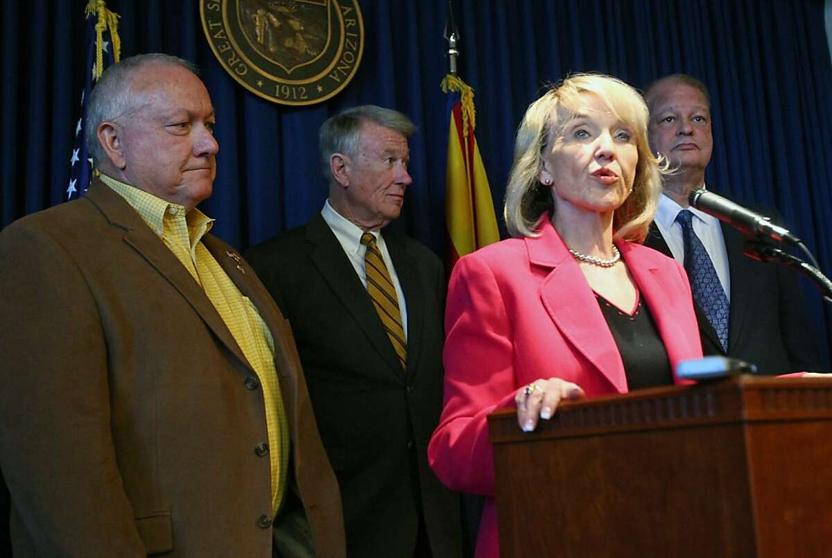 From left, Sen. Russell Pearce, attorney John Bouma, Gov. Jan Brewer, and Attorney General Tom Horne, hold a news conference to announce the state's decision to appeal to the United States Supreme Court by July 11, a decision by a lower court that put themost controversial parts of the state's immigration enforcement law on hold, Monday, May 9, 2011, in Phoenix.