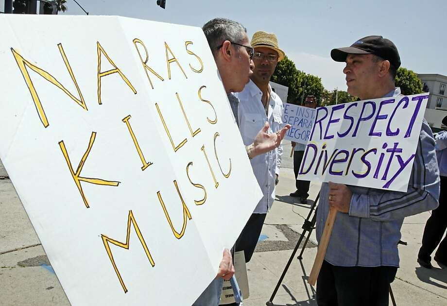 Oscar Hernandez, right, two-time Grammy winner for Latin Jazz Album in 2011 and 2005, joins musicians and others demonstrating outside a meeting of the board of the National Academy of Recording Arts and Sciences (NARAS), demanding restoration of more than 30 categories cut from the Grammy Awards, at the Beverly Hilton Hotel in Beverly Hills, Calif., Thursday, May 26, 2011.  They say the reductions unfairly target ethnic music and were done without the input of the academy's thousands of members. Photo: Reed Saxon, AP