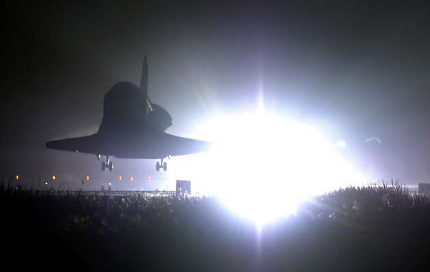 "US space shuttle Endeavour comes in to land at Kennedy Space Center on June 1, 2011. Endeavour landed safely at Kennedy Space Center, wrapping up its final mission to space before becoming the next to last US shuttle to retire. ""It is sad to see her landfor the last time, but she really has a great legacy,"" said shuttle commander Mark Kelly moments after landing the youngest ship in the US fleet, ending its 25th journey to space. Photo: Timothy A. Clary, AFP/Getty Images"