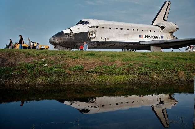 Space Shuttle Endeavour is escorted back to a storage building following it's last mission before being retired, at Kennedy Space Center, on June 01, 2011, in Cape Canaveral, Florida. Endeavour, completing a 16-day mission tooutfit the International Space Station, spent 299 days in space and travelled more than 122.8 million miles during its 25 flights. It launched on its first mission on May 7, 1992. Photo: Roberto Gonzalez, Getty Images