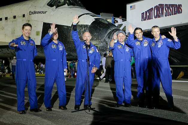"US space shuttle Endeavour Commander Mark Kelly (C), Italian mission specialist Roberto Vittori (L), pilot Gregory Johnson (2nd L) and mission specialists Michael Fincke (3rd R), Greg Chamitoff (2nd R) and Andrew Feustel (R) wave after Endeavour landed atKennedy Space Center on June 1, 2011. Endeavour landed safely at Kennedy Space Center, wrapping up its final mission to space before becoming the next to last US shuttle to retire. ""It is sad to see her land for the last time, but she really has a greatlegacy,"" said Kelly moments after landing the youngest ship in the US fleet, ending its 25th journey to space. Photo: John Raoux, AFP/Getty Images"