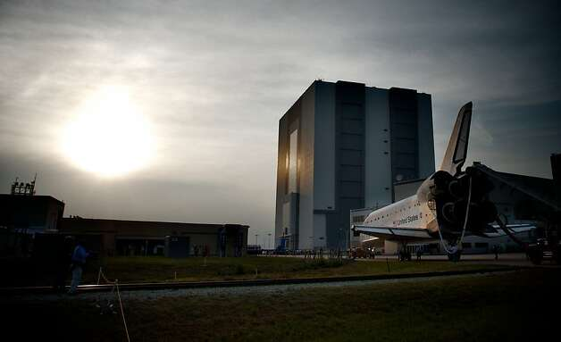 Space Shuttle Endeavour is escorted back to a storage building following it's last mission before being retired, at Kennedy Space Center, on June 01, 2011, in Cape Canaveral, Florida. Endeavour, completed a 16-day mission to outfit the International Space Station, spent 299 days in space and travelled more than 122.8 million miles during its 25 flights. It launched on its first mission on May 7, 1992. Photo: Roberto Gonzalez, Getty Images