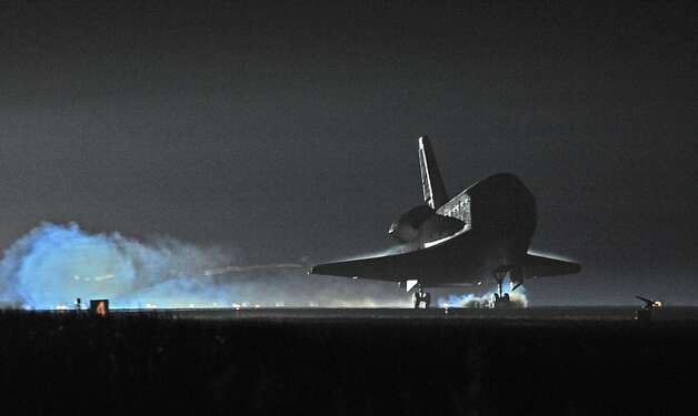 "US space shuttle Endeavour lands at Kennedy Space Center on June 1, 2011. Endeavour landed safely at Kennedy Space Center, wrapping up its final mission to space before becoming the next to last US shuttle to retire. ""It is sad to see her land for the last time, but she really has a great legacy,"" said shuttle commander Mark Kelly moments after landing the youngest ship in the US fleet, ending its 25th journey to space. Photo: Bruce Weaver, AFP/Getty Images"