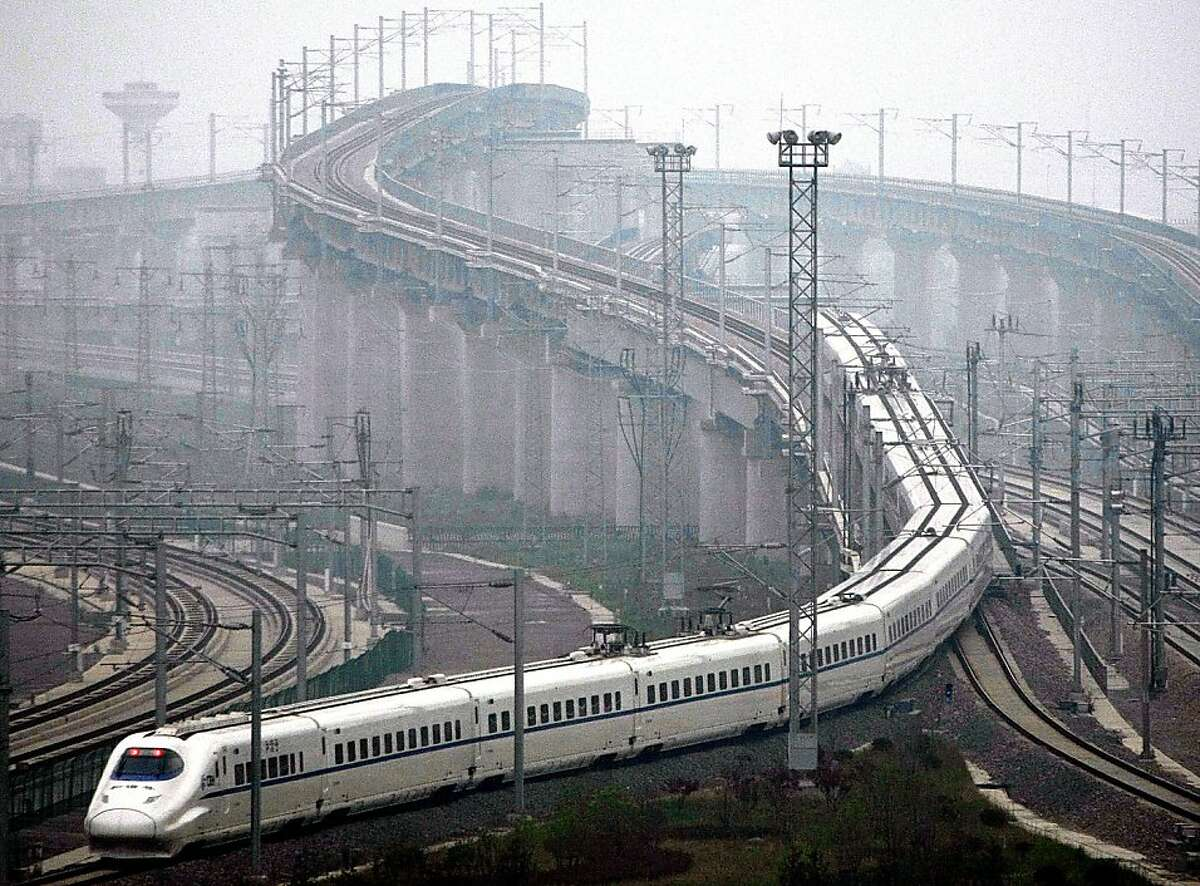 A train which can run at speeds up to 300 kilometres (185 miles) per hour goes on a trial run in Shanghai on May 11, 2011. Trial runs began on the highly anticipated high-speed rail line between Beijing and Shanghai, one month before the link is due to gointo commercial service, state media reported. CHINA OUT