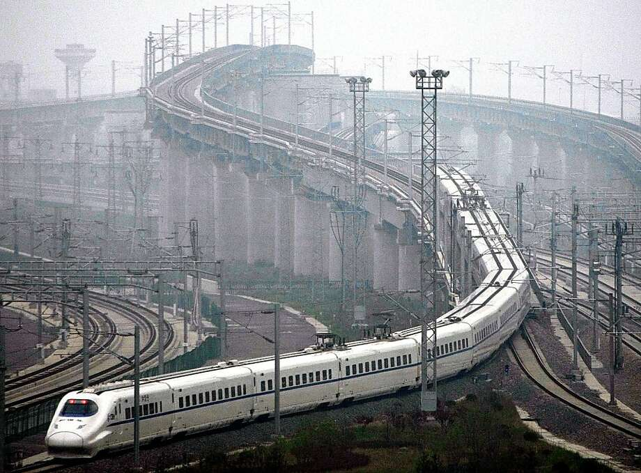 A train which can run at speeds up to 300 kilometres (185 miles) per hour goes on a trial run in Shanghai on May 11, 2011. Trial runs began on the highly anticipated high-speed rail line between Beijing and Shanghai, one month before the link is due to gointo commercial service, state media reported.      CHINA OUT Photo: Str, AFP/Getty Images
