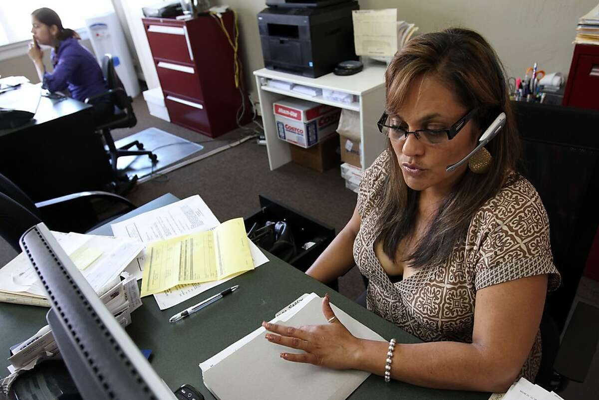 Lilian Cabrera, Insurance Agent for Farmers Insurance, works in her Oakland, CA office on Thursday, May 26, 2011.