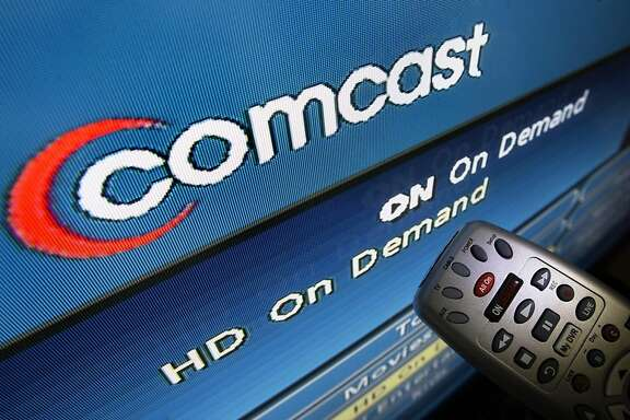 The Comcast logo is displayed on a TV set in North Andover, Mass. Thursday, Aug. 6, 2009. Comcast Corp., the nation's biggest cable TV systems operator, posted a 53 percent increase in second-quarter profit on Thursday, helped by higher prices and increased customer spending on video and Internet services. But subscriber growth markedly slowed as the recession's grip remained tight. (AP Photo/Elise Amendola)