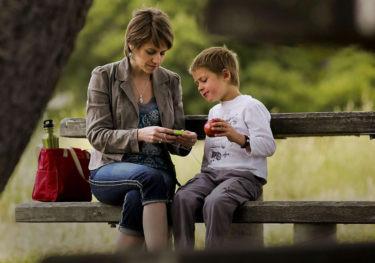 Suzanne Kline and her six-year-old son Merrick Horne, who is diabetic check the numbers on his insulin pump in Corte Madera, Ca., Saturday May 28, 2011. They are part of a court case about who can give insulin to diabetic children while in school.