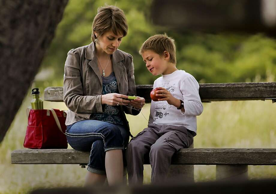 Suzanne Kline and her six-year-old son Merrick Horne, who is diabetic check the numbers on his insulin pump in Corte Madera, Ca., Saturday May 28, 2011. They are part of a court case about who can give insulin to diabetic children while in school. Photo: Michael Macor, The Chronicle