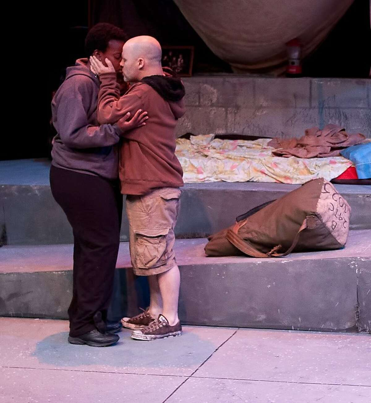 Jenny (Omoze Idehenre,left) and Donald (Jon Tracy) say goodbye in TheatreFirst's production of