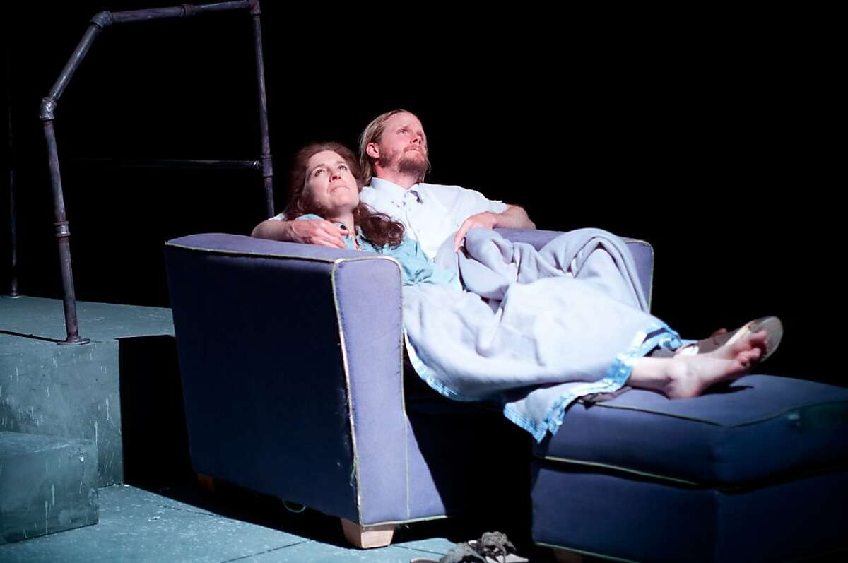 Lou (Nancy Carlin, left) goes to Buddy (Brett Williams) for comfort after another of Jenny's nightmares in TheatreFirst's production of