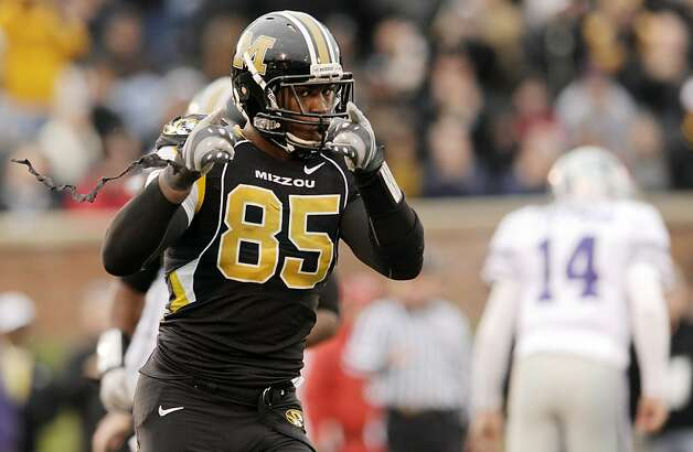 FILE - In this Nov. 13, 2010 file photo, Missouri defensive end Aldon Smith, left, celebrates after sacking Kansas State quarterback Carson Coffman, right, during the third quarter of an NCAA college football game in Columbia, Mo. Smith is a top prospect in the upcoming NFL Draft.  (AP Photo/L.G. Patterson, File) Photo: L.G. Patterson, AP
