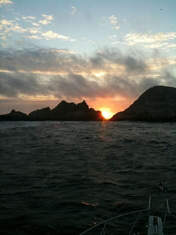 The view of the Farallones as swimmers from the Dolphin Club completed a relay swim from San Francisco to the islands. This photo was taken at 8 p.m. on May 20, 2011.The view of the Farallones as swimmers from the Dolphin Club completed a relay swim from San Francisco to the islands. This photo was taken at 8 p.m. on May 20, 2011. Photo: Courtesy Vito Bialla