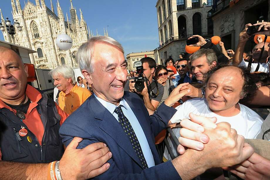 Newly elected mayor of Milan Giuliano Pisapia greets supporters at Piazza Duomo after winning the local elections on May 30, 2011 in Milan. Milan -- a stronghold of the right for the past 18 years -- has been won by Pisapia, 62, a criminal lawyer with a long history of leftist activism. Photo: Olivier Morin, AFP/Getty Images