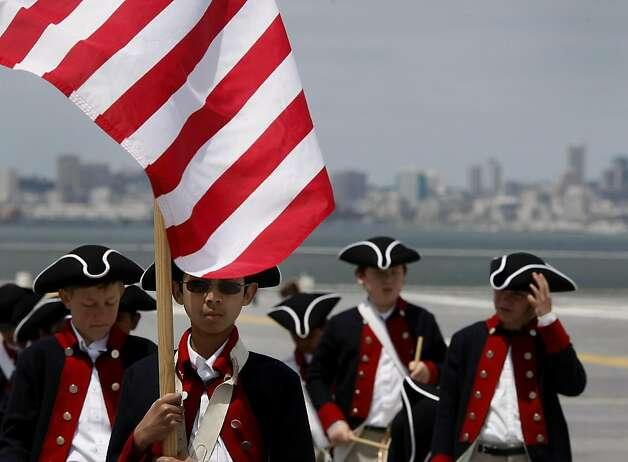Members of the Young America Patriots Fife and Drum Corp from Pleasanton rehearse on the flight deck of the USS Hornet. Memorial Day was celebrated on board the Hornet on Monday in Alameda. Photo: Brant Ward, The Chronicle