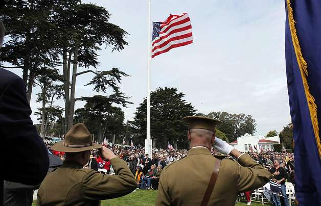 The flag is raised to open Memorial Day services at the San Francisco National Cemetery on Monday. Photo: Carlos Avila Gonzalez, The Chronicle