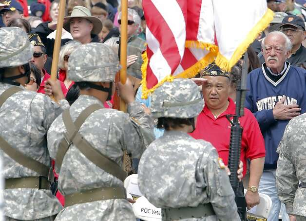 Ron Lee, commander of Cathay Post 384, salutes during the playing of the Star Spangled Banner to open services for Memorial Day at the San Francisco National Cemetery on Monday. Photo: Carlos Avila Gonzalez, The Chronicle