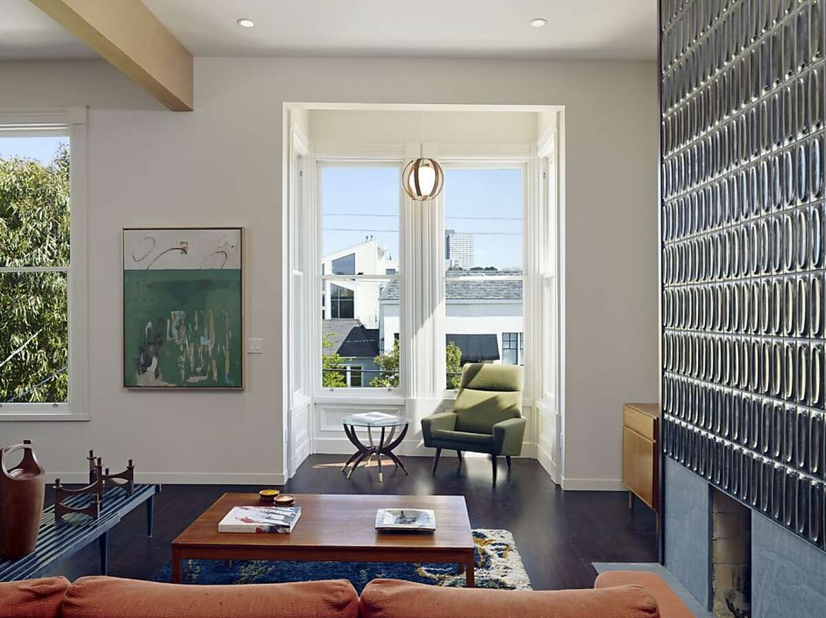 After her Victorian flat suffered extensive fire damage, Janna Stark seized the opportunity to give her home a modern makeover. . The architects placed the living room and open kitchen at the front of the house, creating that casual entertaining space.