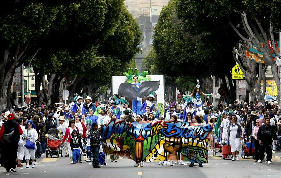 The group Seeds of Change and other acts made their way down 24th Street Sunday morning. The annual Carnaval parade down 24th Street and Mission Streets drew thousands of spectators despite the cold temperatures Sunday morning May 24, 2009. Photo: Brant Ward, The Chronicle