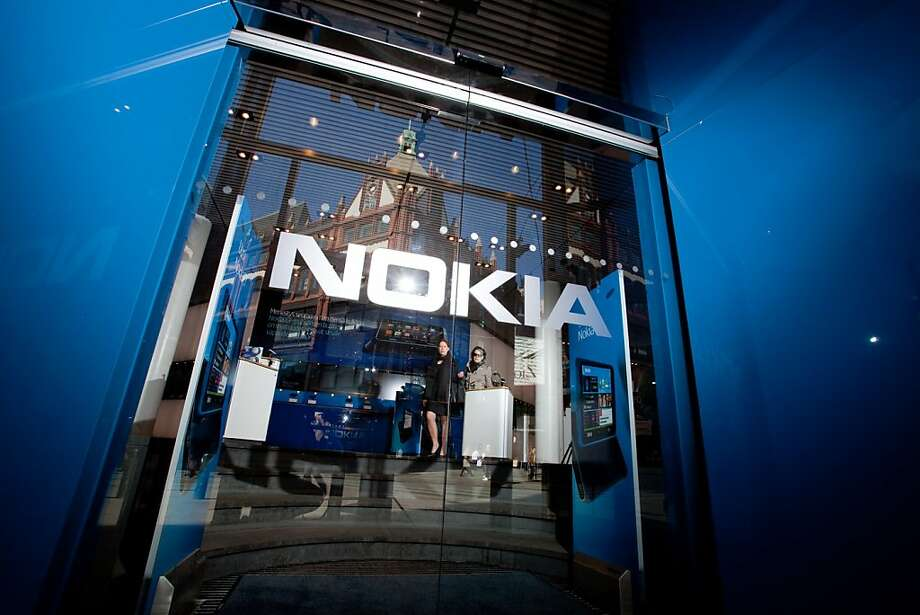 The entrance to a Nokia Oyj mobile phone store is seen in Helsinki, Finland, on Thursday, April 21, 2011. Nokia Oyj reported a smaller-than-expected decline in profit and will slash 1 billion euros ($1.5billion) in expenses at the handset business as it seeks to regain lost ground through a partnership with Microsoft Corp. Photographer: Henrik Kettunen/Bloomberg Photo: Henrik Kettunen, Bloomberg