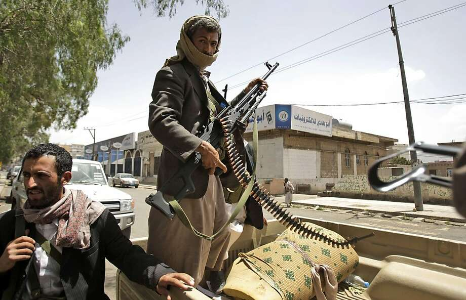 Armed Yemeni tribesmen stand guard in a street in Sanaa, Yemen, Sunday, May 29, 2011. With diplomatic efforts stalled, the political crisis gave way to serious street battles last week between Saleh's forces and armed men loyal to one of the country's most powerful tribal leaders, who has turned against the president. The clashes killed 124 people and raised fears of a civil war before the two sides reached a cease-fire agreement over the weekend. (AP Photo/Hani Mohammed) Photo: Hani Mohammed, AP