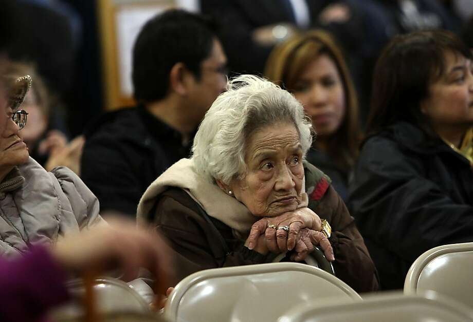 Maxima Simpliciano, 83 years old, listens to speakers during the first in a series of town hall city budget meetings at Tenderloin Community School, in San Francisco, Calif., with mayor Ed Lee and supervisor Jane Kim on Wednesday, March 16, 2011.  The city is facing a i$380 million deficit. Photo: Liz Hafalia, The Chronicle