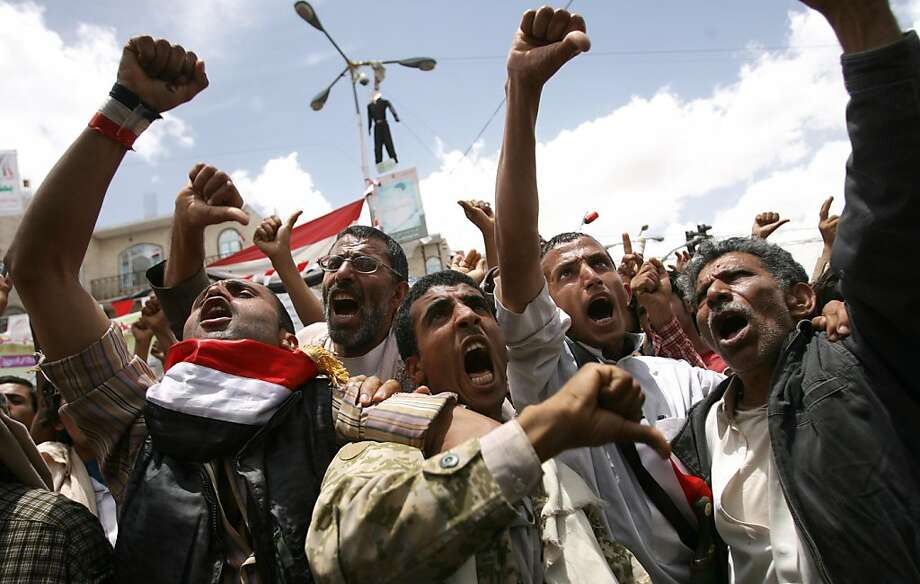 "Anti-government protestors show the ""tumbs-down"" as they shout demanding the resignation of Yemeni President Ali Abdullah Saleh, in Sanaa on May 23, 2011, as Yemen's opposition vowed to step up street protests but said it was determined to avoid violence,after President Saleh refused to sign a Gulf-brokered deal for his leaving office. Photo: Mohammed Huwais, AFP/Getty Images"