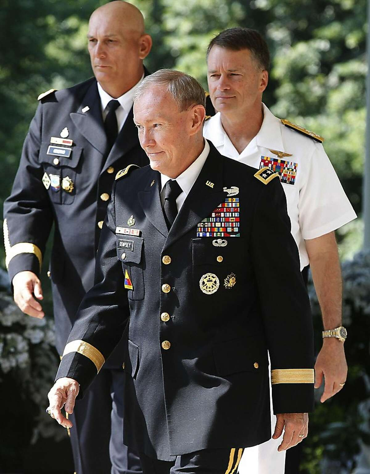 President Obama's nominee for the next Chairman of the Joint Chiefs of Staff Army Gen. Martin Dempsey, nominee Adm. James Winnefeld, right, to be vice chairman of the Joint Chiefs, and Gen. Ray Odierno, left, to be Army Chief of Staff walk to a Rose Garden announcement ceremony at the White House in Washington Monday, May 30, 2011.