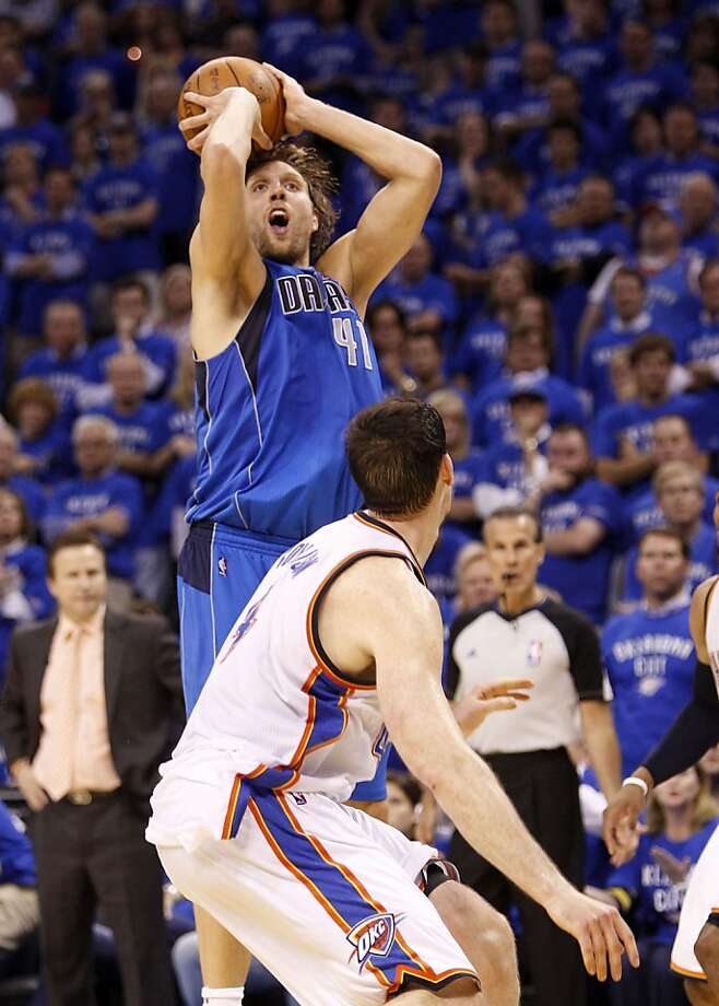 Dallas Mavericks forward Dirk Nowitzki of Germany shoots over Oklahoma City Thunder's Nick Collison, front, in the second half of  Game 4 of the NBA Western Conference finals basketball series Monday, May 23, 2011, in Oklahoma City. Photo: Eric Gay, AP