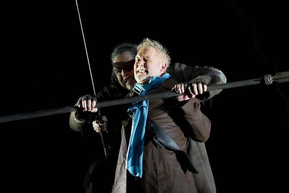 """Mark Delavan, left, as Wotan The Wanderer, and Siegfried, performed by Jay Hunter Morris, fights during the third art of The Ring of Nibelung, titled """"Siegfried"""" at War Memorial Opera House in San Francisco, Calif. on Thursday, May 26, 2011. Photo: Stephen Lam, Special To The Chronicle"""
