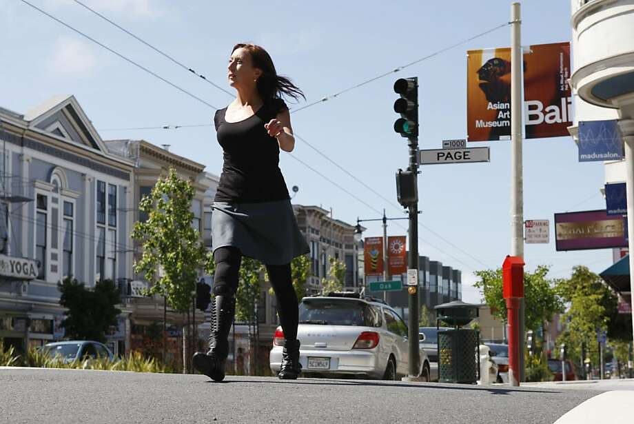Deborah Bevilacqua walks down Divisadero in San Francisco Calif, on Friday, May 27, 2011. Bevilacqua's right leg is a prosthetic she has had customized and she now enjoys accessorizing to match it. Photo: Alex Washburn, The Chronicle