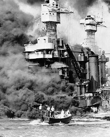 A ship is engulfed in smoke on Dec. 7, 1941 - a day remembered by Greenwich resident Norm Burger, who was a young boy in Hawaii when the attck occurred. Photo: Contributed Photo