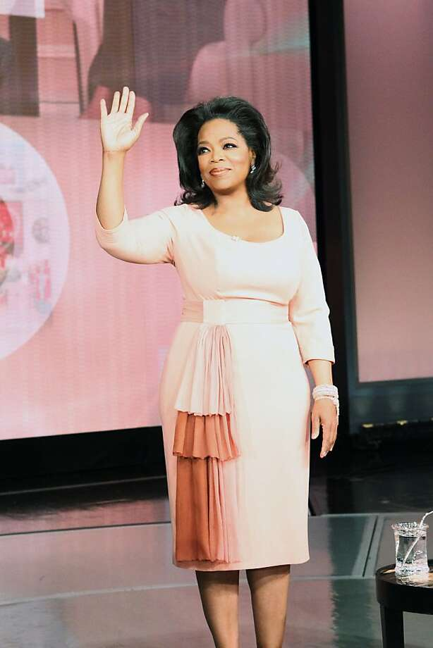 In this photo provided by Harpo Productions Oprah Winfrey waves as her show taped for the last time Tuesday, May 24, 2011, in Chicago. The show, which aired Wednesday, was all about the one thing that made her a billion-dollar success: the unique connection she made with millions of viewers for 25 years. Photo: George Burns, AP