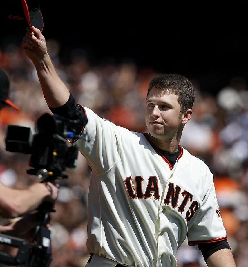 Buster Posey acknowledges the applause of the fans as he is introduced as the 2010 Rookie of the Year before the Giants' game against the St. Louis Cardinals at AT&T Park on Sunday. Photo: Brant Ward, The Chronicle