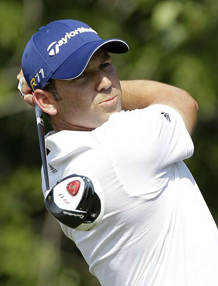 Sergio Garcia of Spain tees off on the 15th hole during the second round of the Byron Nelson Championship golf tournament  Friday, May 27, 2011, in Irving, Texas. Garcia finished the round with a two-day score of 8-under, 132, tied for the lead with RyanPalmer going into the third round on Saturday. Photo: Tony Gutierrez, AP