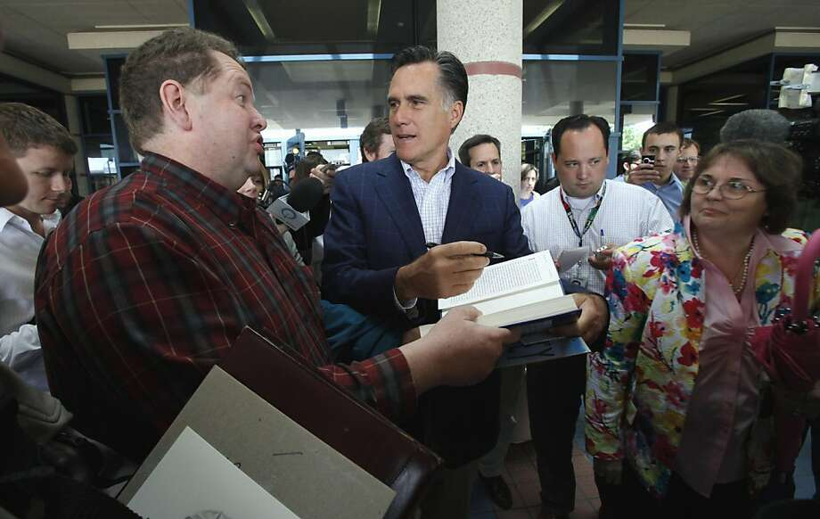 Former Massachsetts Gov. Mitt Romney, center, signs autographs after speaking at the Mediacom 2012 Presidential Candidate Series, Friday, May 27, 2011, in Des Moines, Iowa.  The event was cut short when a smoke alarm went off in the building. Photo: Charlie Neibergall, AP