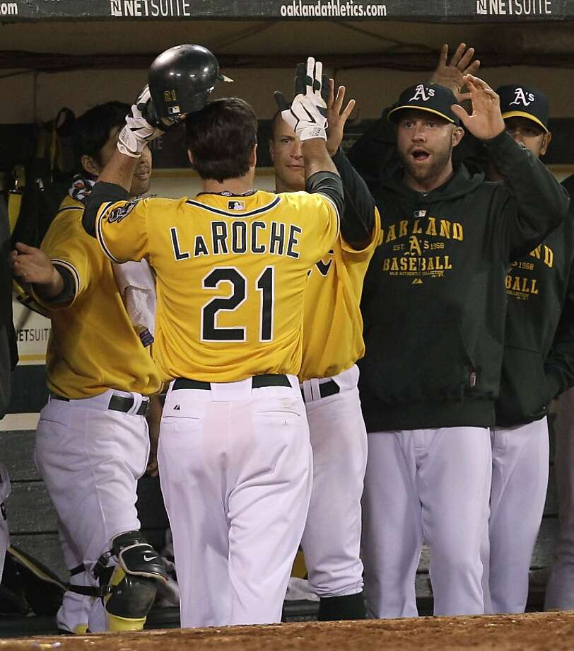 Oakland Athletics' Andy LaRoche (21) is congratulated upon his return to the dugout after scoring against the Baltimore Orioles during the sixth inning of a baseball game Friday, May 27, 2011, in Oakland, Calif. LaRoche scored on a single by Ryan Sweeney. Photo: Ben Margot, AP