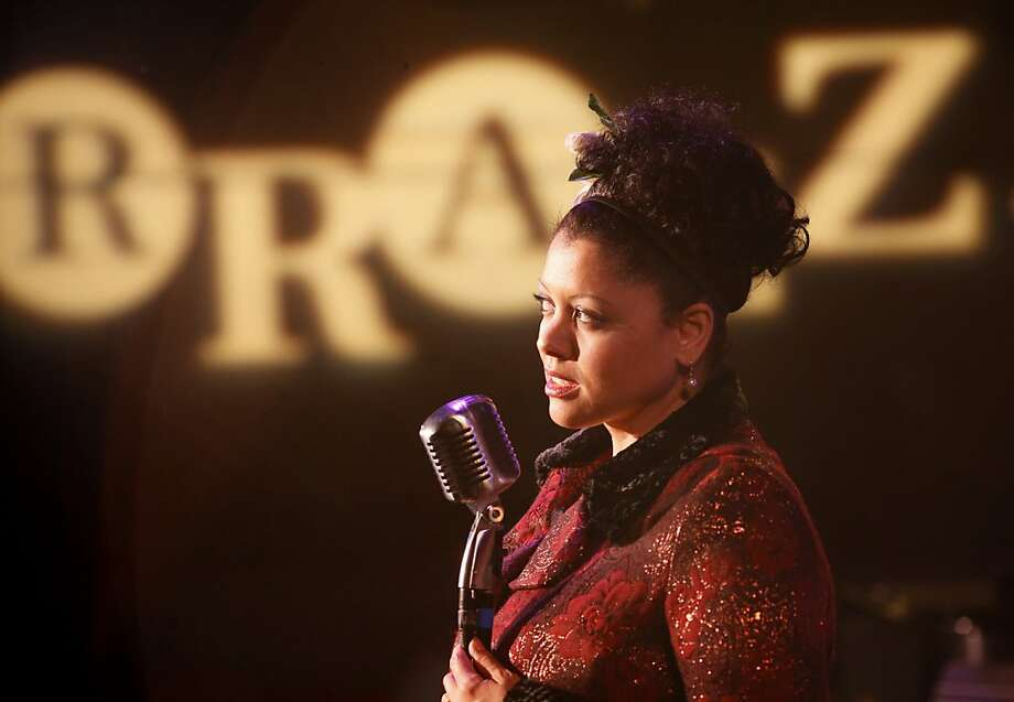 Kim Nalley gets comfortable with a microphone on stage at the Rrazz Room. Jazz singer Kim Nalley is crazy about the Rrazz Room at the Hotel Nikko in San Francisco, Calif. where she sometimes performs. Photo: Brant Ward, The Chronicle