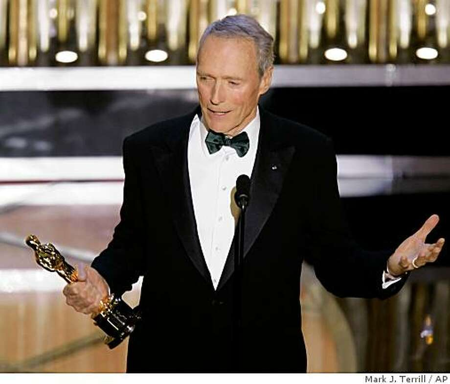 "Director Clint Eastwood accepts the Oscar for best director for his work on ""Million Dollar Baby"" at the 77th Academy Awards Sunday, Feb. 27, 2005, in Los Angeles. Photo: Mark J. Terrill, AP"