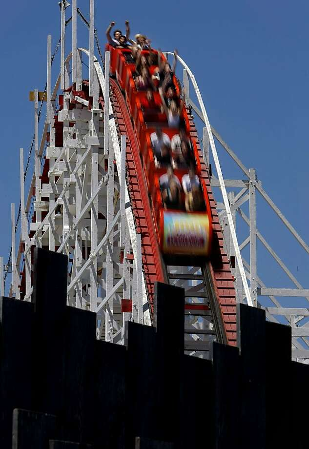 """Riding the """"Giant Dipper"""" roller coaster in Santa Cruz, Calif. on June 4, 2008 at the Santa Cruz Beach and Boardwalk. Photo By Michael Macor/ The Chronicle Photo: Michael Macor, The Chronicle"""