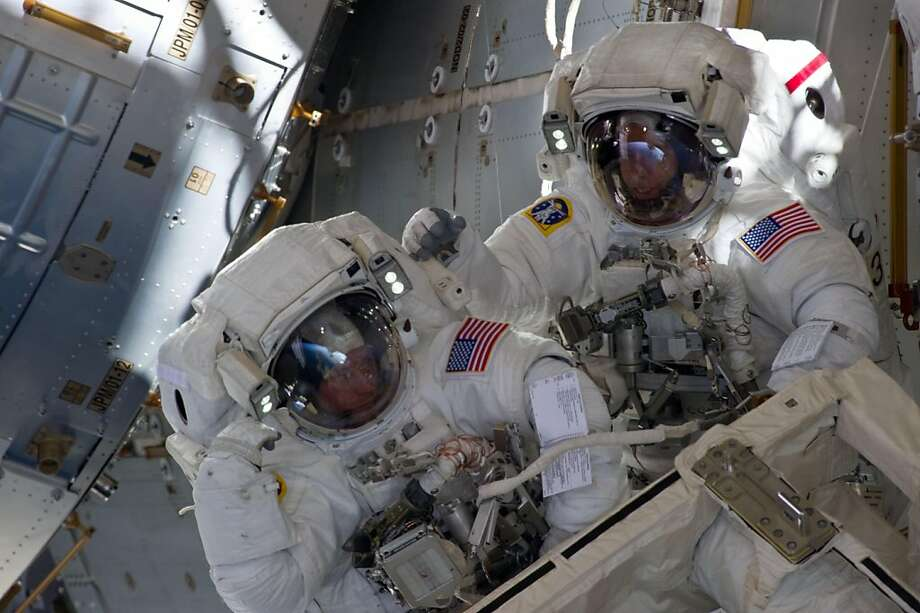 This NASA photo released on May 27, 2011 shows with components of the International Space Station in the view, NASA astronauts Andrew Feustel (R) and Michael Fincke during the STS-134 mission's third spacewalk on May 26, 2011. They coordinated their shared activity with NASA astronaut Greg Chamitoff, who stayed in communication with the pair and with Mission Control Center in Houston from inside the station. The crew of the US space shuttle Endeavour wrapped up their fourth and final spacewalk on May 27,2011, a walkabout that surpassed the 1,000th hour of such trips to build the International Space Station.The marathon seven hour, 24 minute spacewalk began at 7:39 am (0415 GMT) and mission specialists Mike Fincke and Greg Chamitoff finished at 7:39 am Photo: Ho, AFP/Getty Images