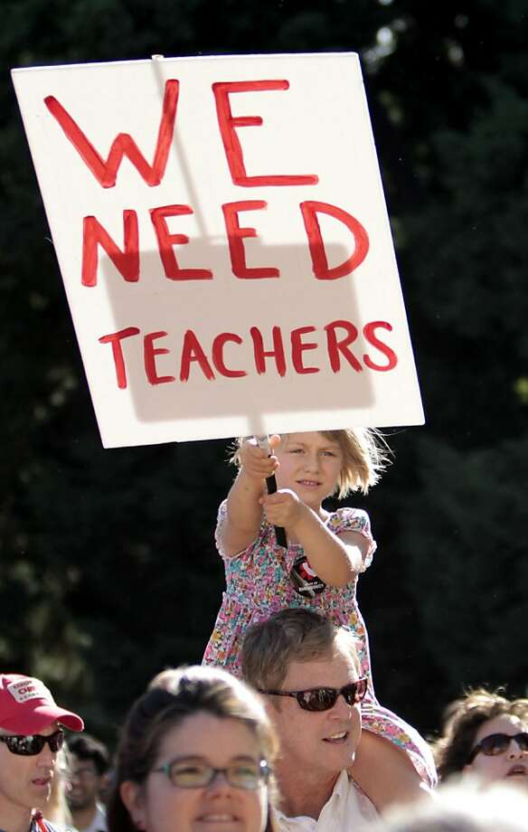 Anya Westerfield, 5, sits on her father, Bill's shoulders during a demonstration against proposed budget cuts to education at the Capitol in Sacramento, Calif., Friday, May 13, 2011.  More than 2,000 teachers, students and supporters protested the threatof deep budget cuts to public education and called on lawmakers to extend temporary increase to the sales, personal income and vehicle taxes that will expire June 30. Photo: Rich Pedroncelli, AP