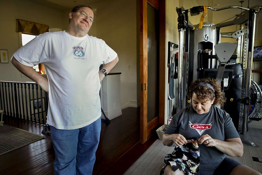 Nancy Lasseter opens the arm holes she had sewn shut as an April fools prank on the shirt her husband, John, wanted to wear for the day on Friday, April 1, 2011 in Glen Ellen, Calif. Photo: Russell Yip, The Chronicle