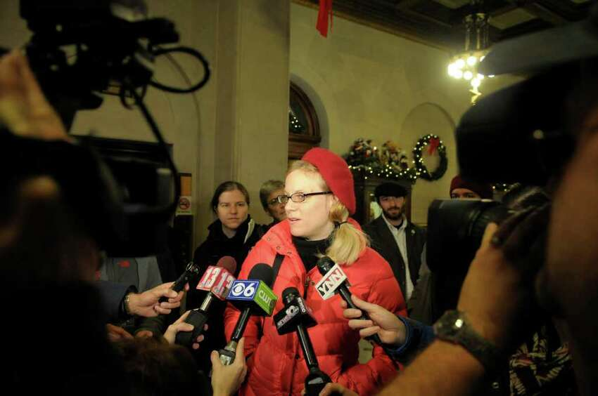 Occupy Albany member, Hezzie Johanson speaks with the media following a meeting at Albany City Hall on Wednesday, Dec. 7, 2011 in Albany, NY. Representatives with Occupy Albany met with city officials to work through the permit process for the Occupy Albany encampment. (Paul Buckowski / Times Union)