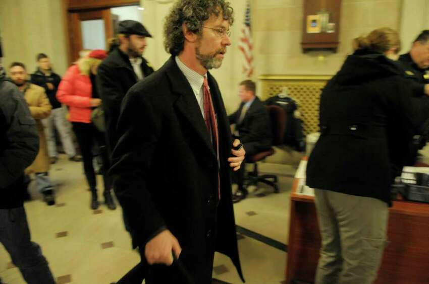 Mark Mishler, a lawyer for Occupy Albany, makes his way to a meeting at Albany City Hall on Wednesday, Dec. 7, 2011 in Albany, NY. Representatives with Occupy Albany met with city officials to work through the permit process for the Occupy Albany encampment. (Paul Buckowski / Times Union)
