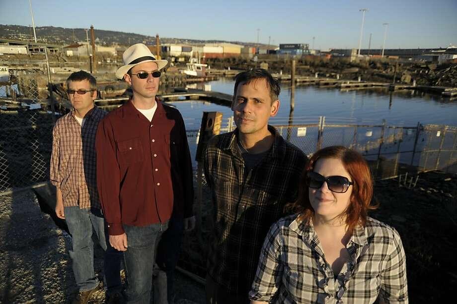 Lisa Mezzacappa's Bait & Switch: (from left) Aaron Bennett, tenor sax; John Finkbeiner, electric guitar; Vijay Anderson, drums; Lisa Mezzacappa, bass. Photo: Myles Boisen
